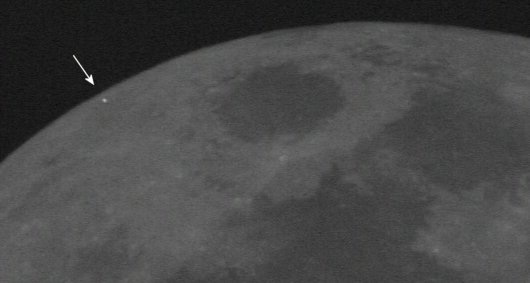 Flash of a Leonid impact captured on the limb of the Moon in 2006. Click image to see animation. (Credit: NASA Meteoroid Environment Office).